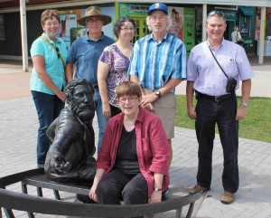 Descendants of William Henry Pope pose with the bronze sculpture of their ancestor, who seems pleased!
