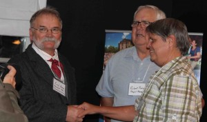 PEIGS President Fred Horne and Project Manager Bob Pierce greet T H Haviland descendant Sandra George Diorio