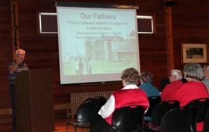 Emcee Bob Pierce introduces historian Dr Ed MacDonald.