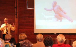 Dr Ed elaborates on a point concerning W H Pope whose new bronze statue is pictured on the screen