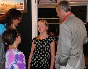 Minister Robert Henderson meets fiddler Caitlin MacAulay.